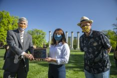 Jim Spain presents Hesburgh scholarship plaque to Sydney Boeger while William Horner stands by.