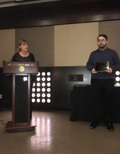Ethan Anderson receiving award
