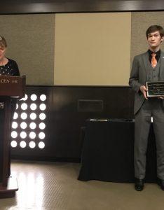 Sage Eichenburch receiving award