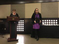 Tessi Rickabaugh receiving award